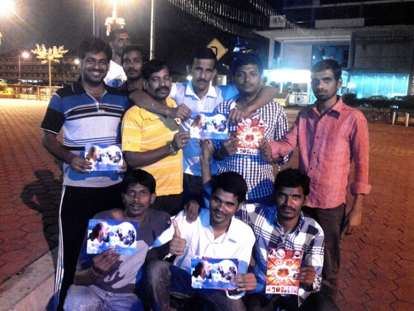 Temple-goers pose for the camera after receiving the message of Kalki Avatar Ra Gohar Shahi.