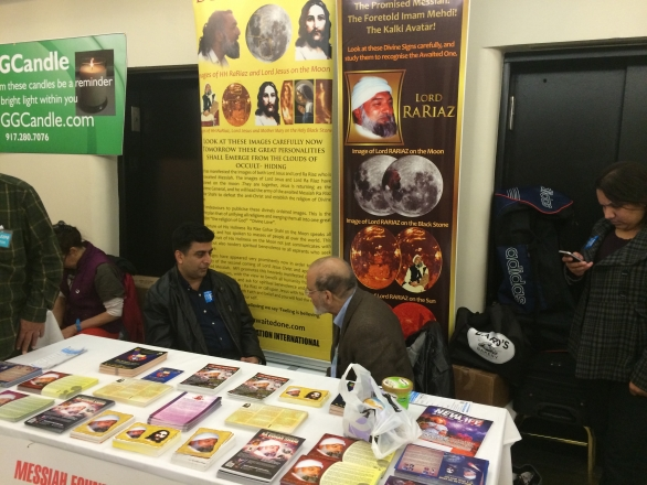 An aspirant discusses the teachings of His Divine Eminence Ra Riaz Gohar Shahi with a member of MFI at the  New Life Expo in New